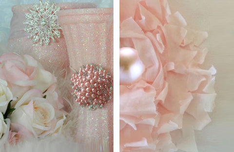 Wedding centerpieces and floral bloom centers decorated with pink brooches.