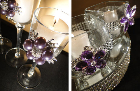 Wedding stem candles and votive holders decorated with purple rhinestone brooches.