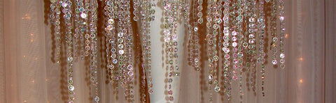 "Beads stands create a ""crystal rain"" effect."