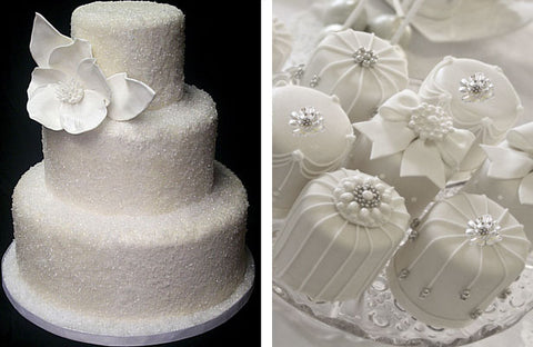 Wedding cake and specialty desserts decorated with white rhinestone brooches.