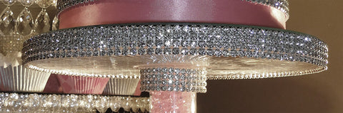 Beautiful Swarovski rhinestone banding wraps the edges of this buffet server.