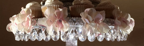 Dripping teardrops accent the stand that displays your wedding cake cupcakes.