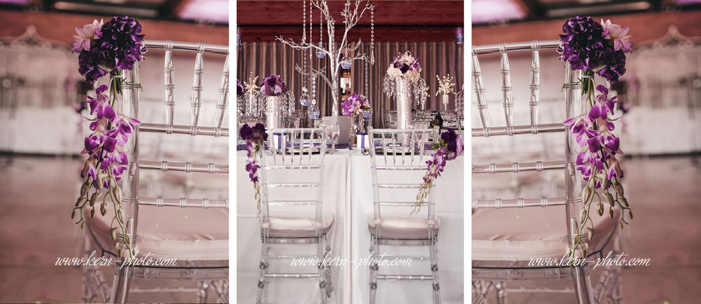 Decorate your head table chairs with floral accents.