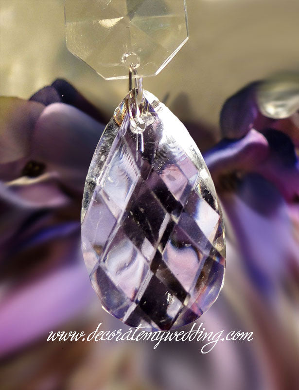 Our teardrop beads have a criss-cross design and are available in glass or acrylic.