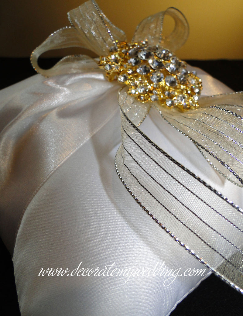 A close up look at the white satin fabric used to create the ring pillow.
