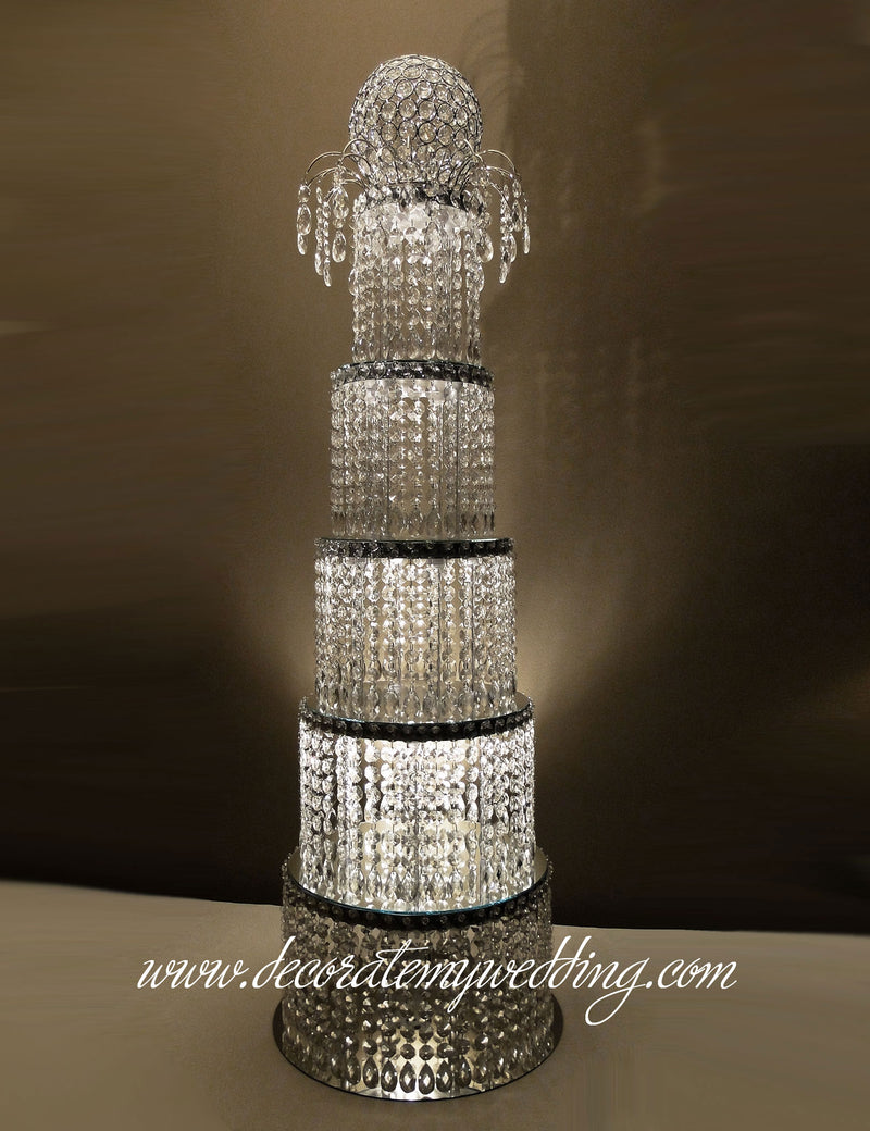 Five illuminated crystal tiers stacked one on top of the other and topped with a graceful arch and beaded globe.
