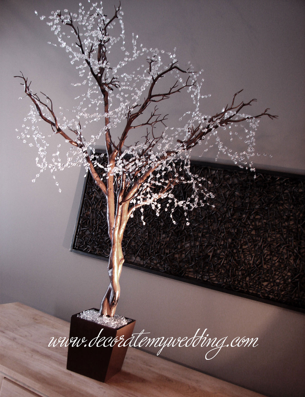 Artificial tree with a crystal beaded garland creates a frosty look.