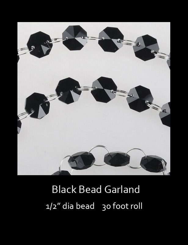 Three black bead garlands showing how the beads are connected together with silver rings.