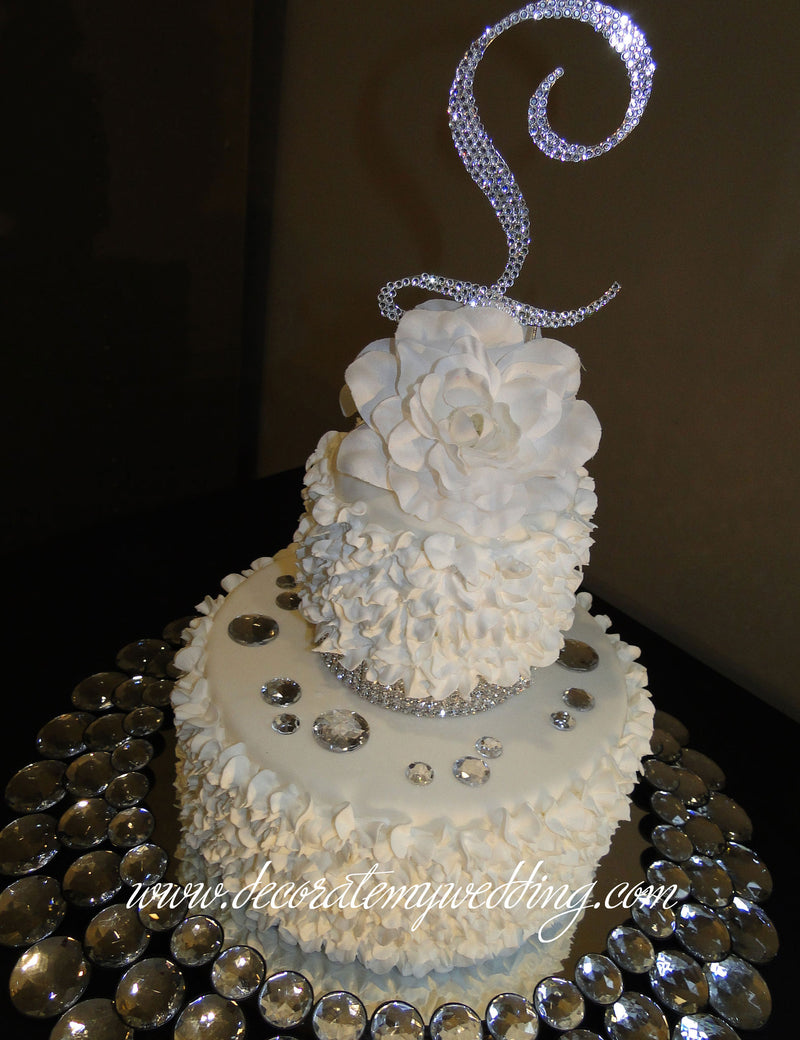 A close up look at the loose rhinestones scattered on the cake.