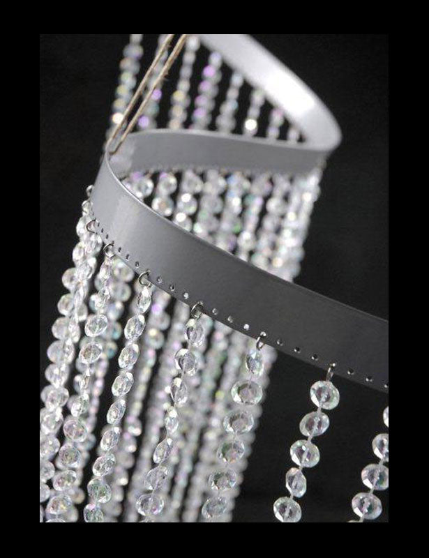 This bendable beaded curtain panel has a flexible band on the top allowing it to wrap around many different shapes and sizes.