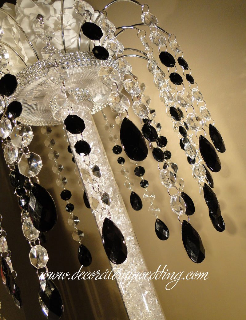 This black and white centerpiece is a made with a combination of both clear and black octagon beads and teardrops.