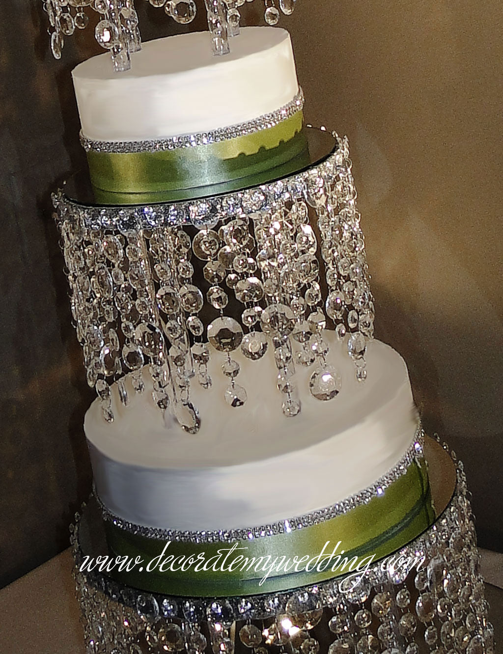 This cake stand with its circle hanging crystals has a very contemporary presentation.