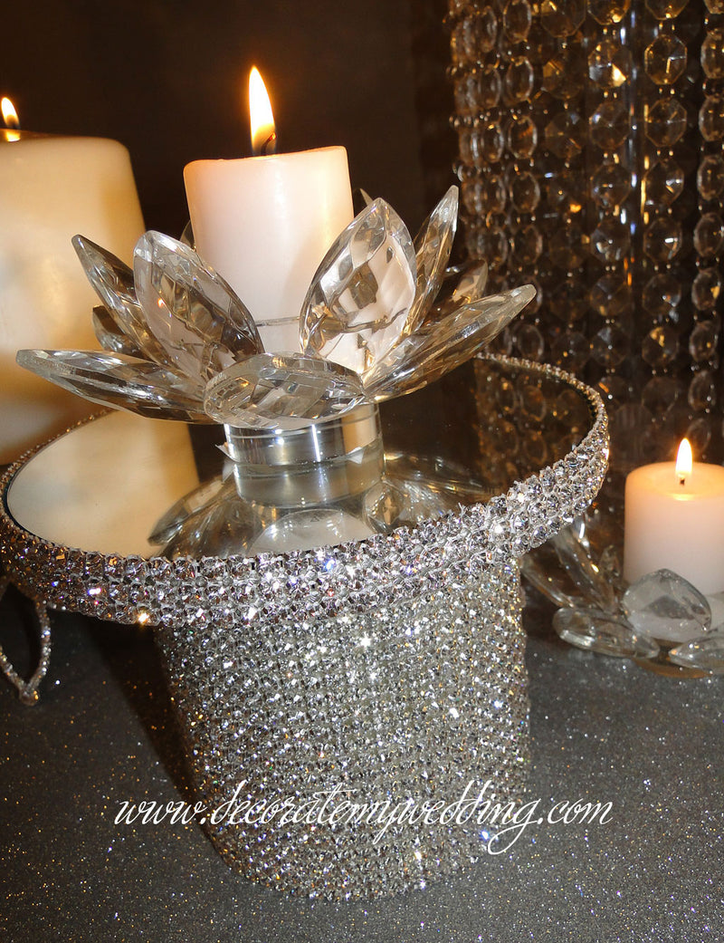 Candle holder completely covered with Swarovski rhinestones, and a mirrored top.