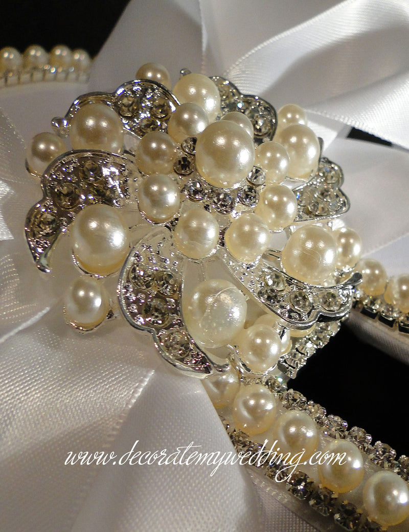 Card box is accented with a pearl and rhinestone brooch.