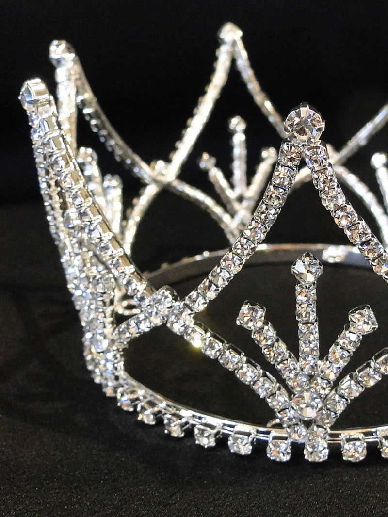 A close up look at the rhinestone completely covering the crown decoration.