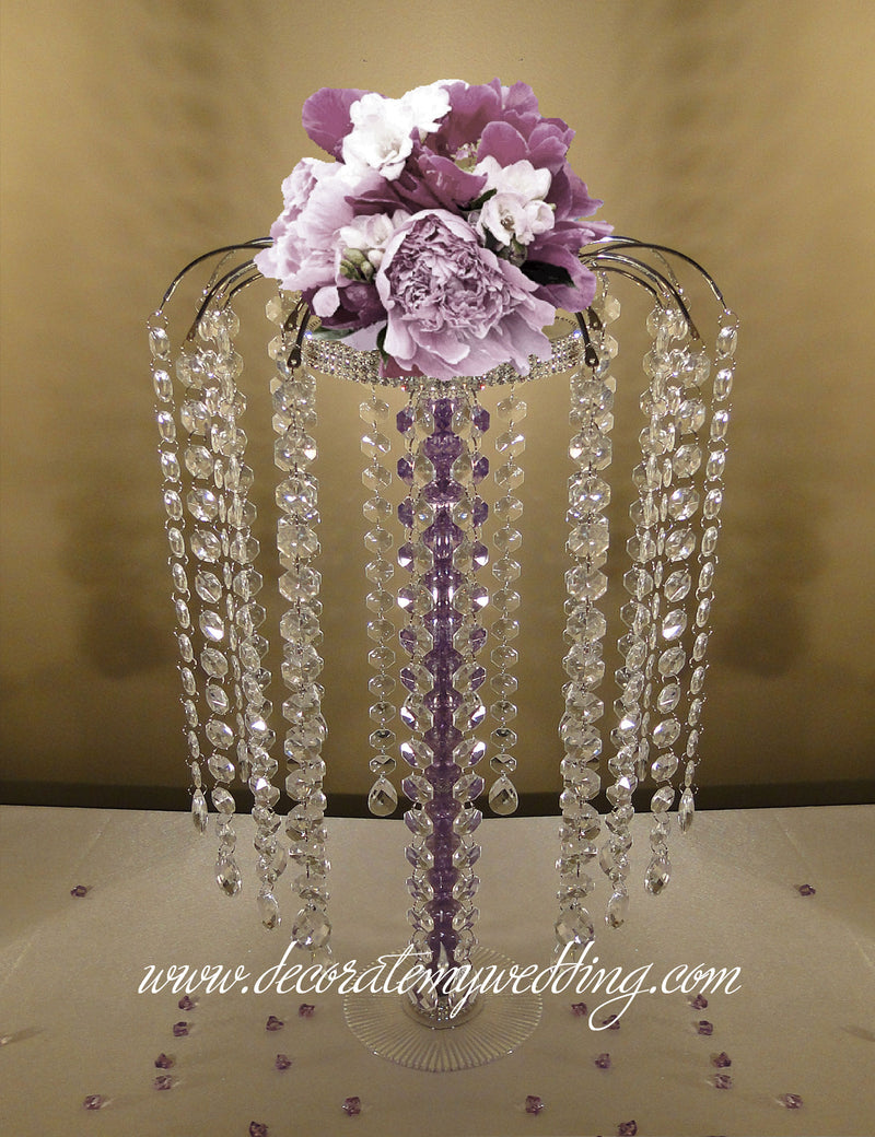 Fill the acrylic tube with colored pebbles or beads, and add a complimentary floral bouquet for added color.