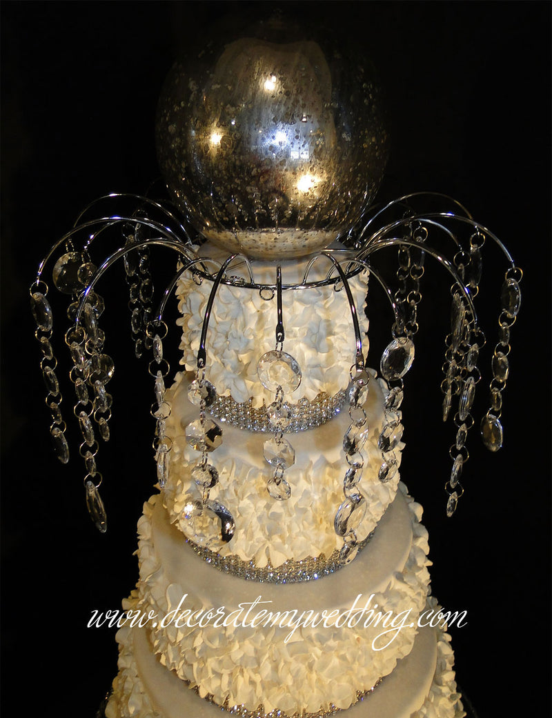 A top down look a the cake decoration with hanging crystal beads.