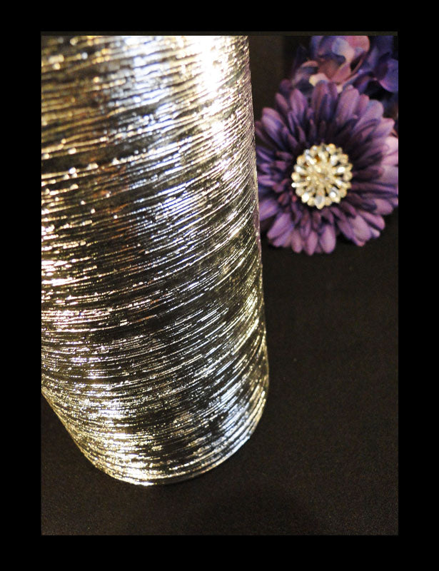 A close up look at the texture of the centerpiece vase.