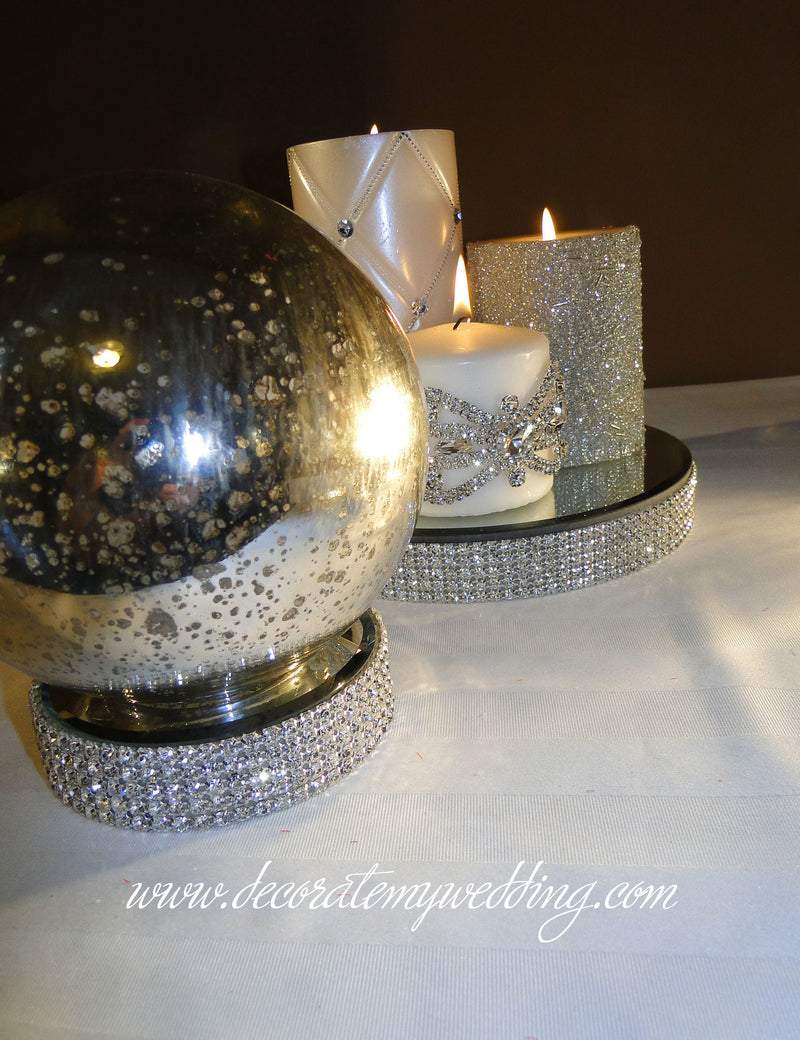 HOW TO USE - A trio of candles and a silver globe displayed on the candle holders.