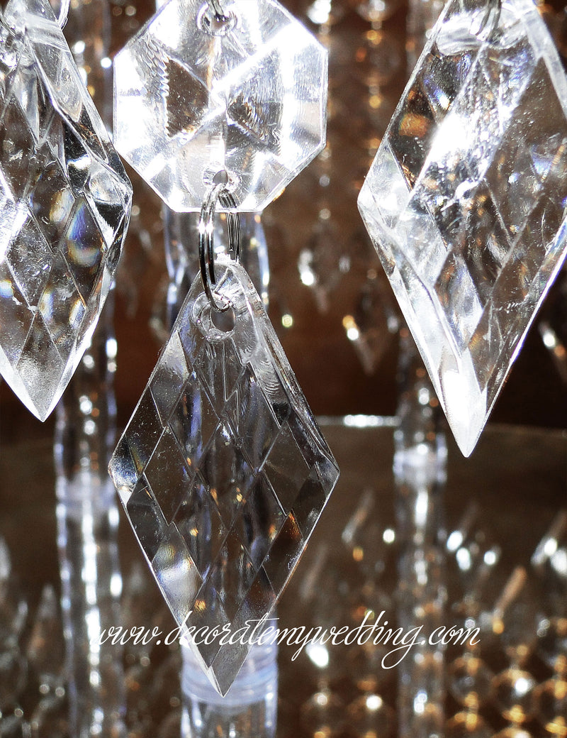 A close up look at the diamond pendants that dangle from the cake stand.