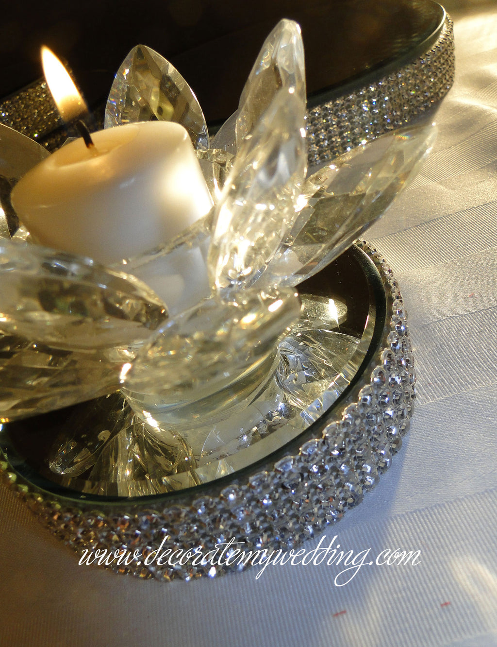 Decorate candle holder is wrapped with Swarovski rhinestone banding and a beautiful beveled mirror.