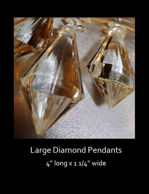 "The acrylic, large diamond bead pendant is crystal clear and measures 4"" long."