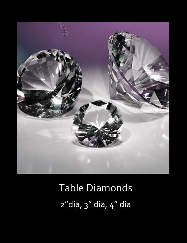 Three sizes of crystal clear, faceted diamond table decorations.