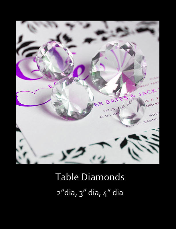 Diamonds are used as an accent on an escort card table.