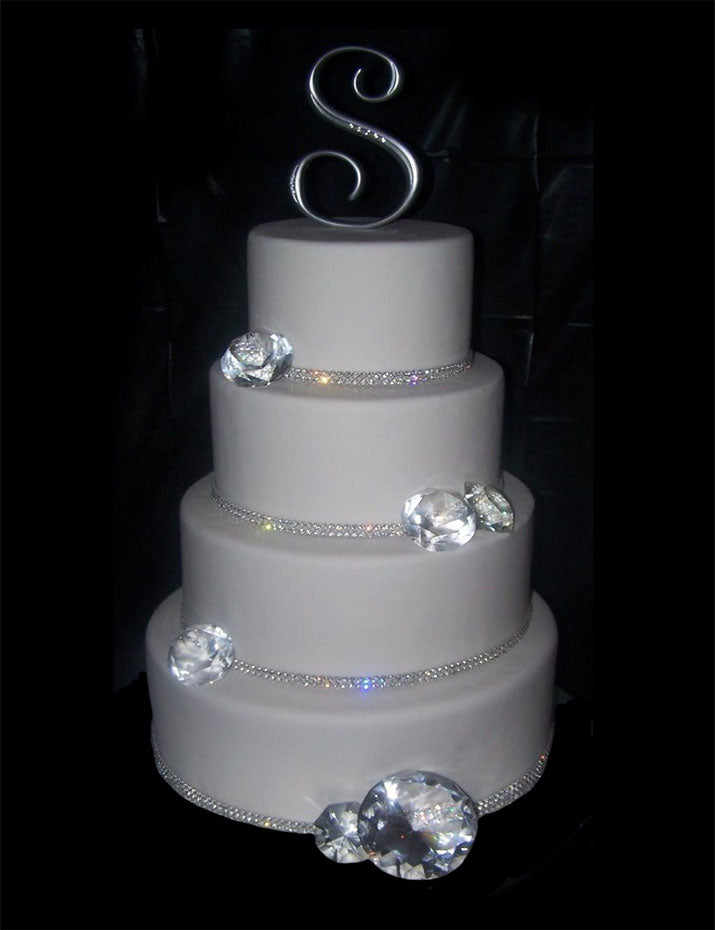 Wedding cake decorated with sparkling diamonds and rhinestone banding.