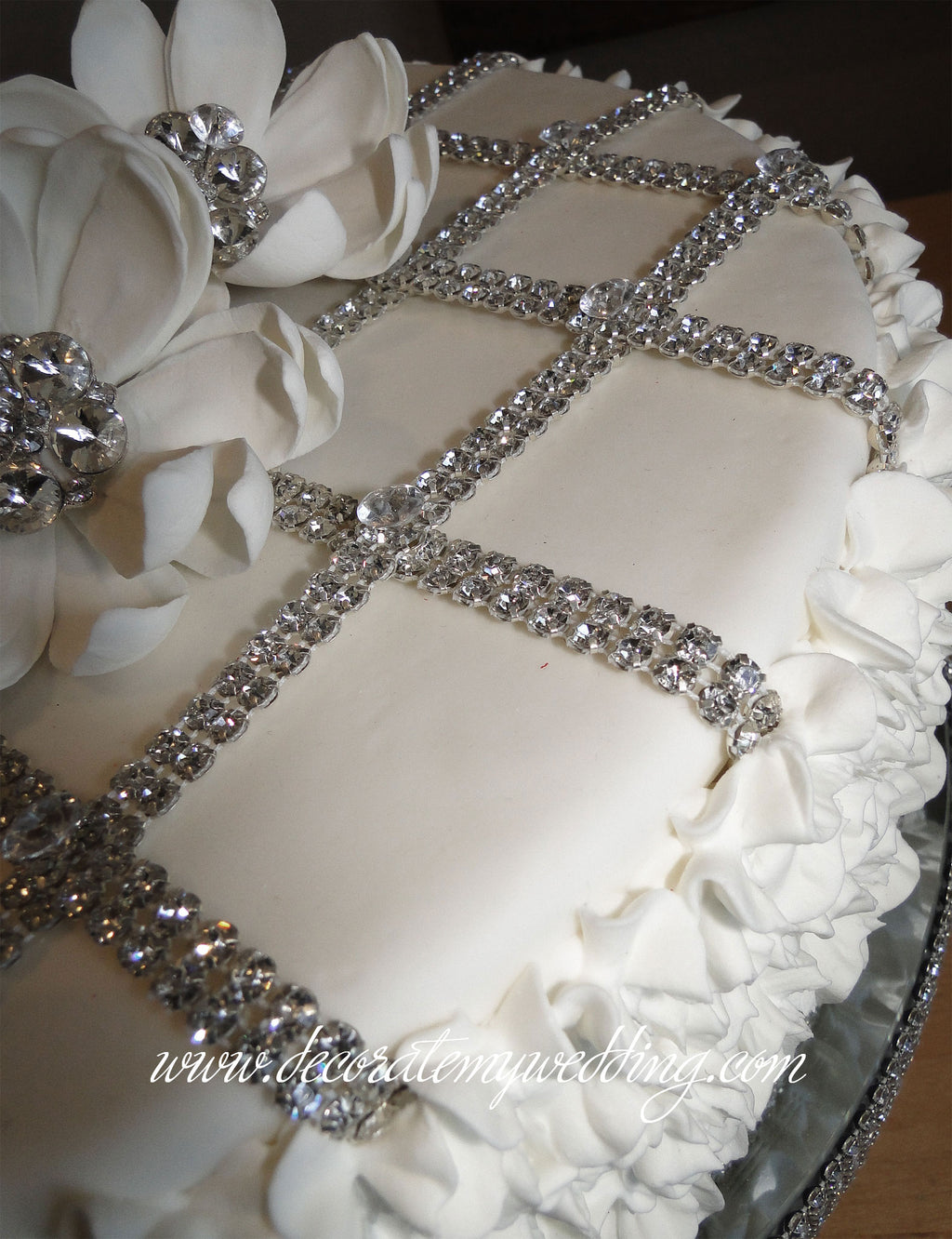 The grid design of this dummy wedding cake layer can be added to the Rachel Ruffle layers for more interest and variation.