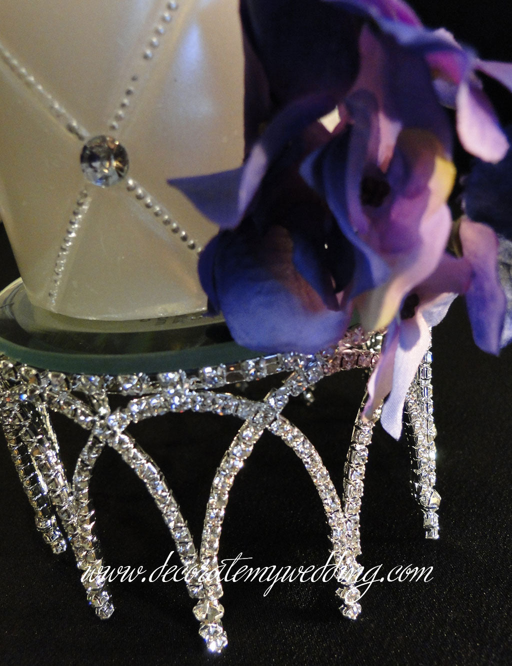 This elegant candle holder has a column-design that is completely covered with crystal rhinestones, and topped with a beautiful beveled mirror.