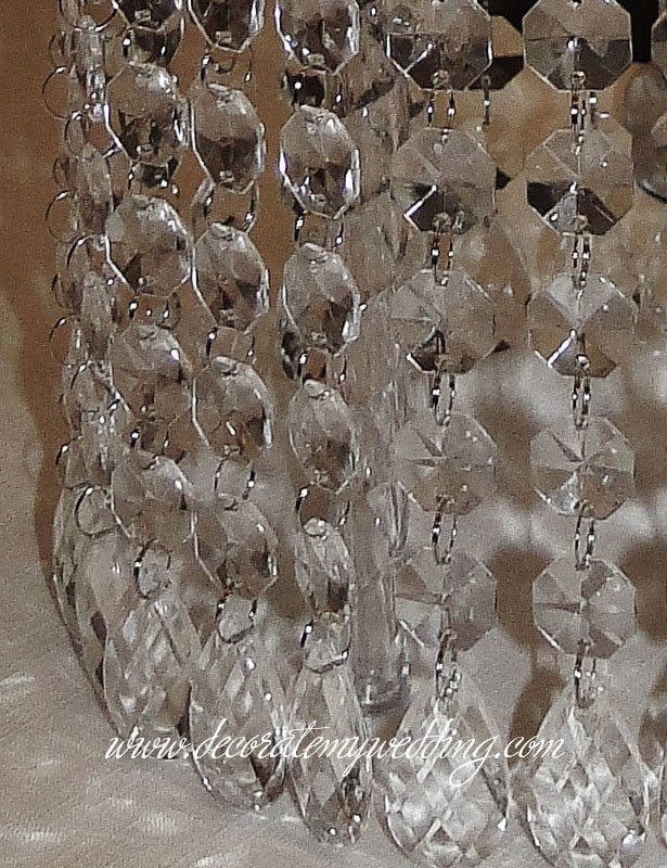 A close up look at the hanging octagon bead strands and teardrops.