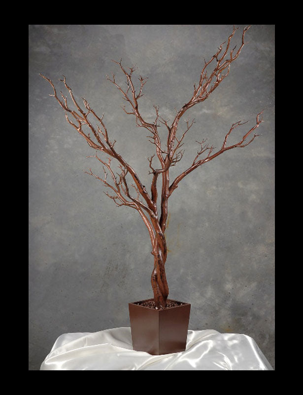 This brown fake trees looks as real as a live manzanita.