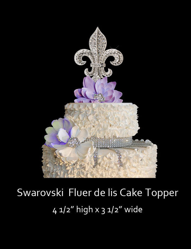 A full view of the fleur de lis cake topper on the top of a wedding cake.