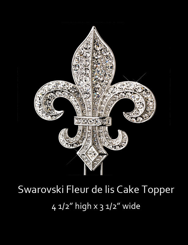The fleur de lis cake topper is completely covered with Swarovski rhinestones and two prongs extend from the bottom of the topper.