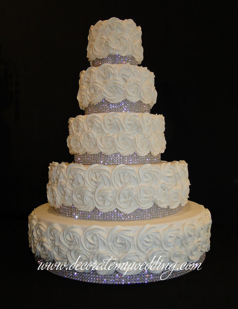 You can stack as many layers are you desire to create a tall wedding cake tower.