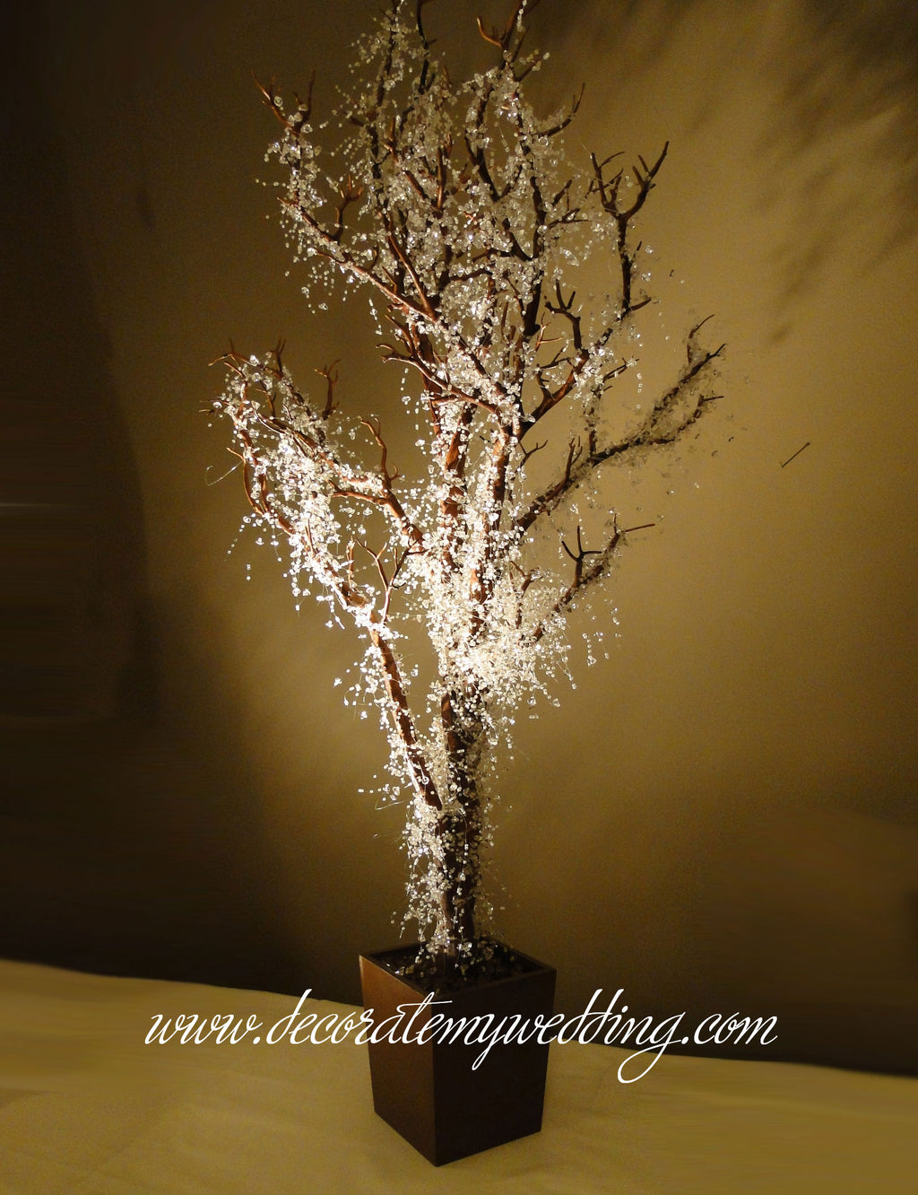 Frosty garland on tree make a perfect winter wonderland decoration.
