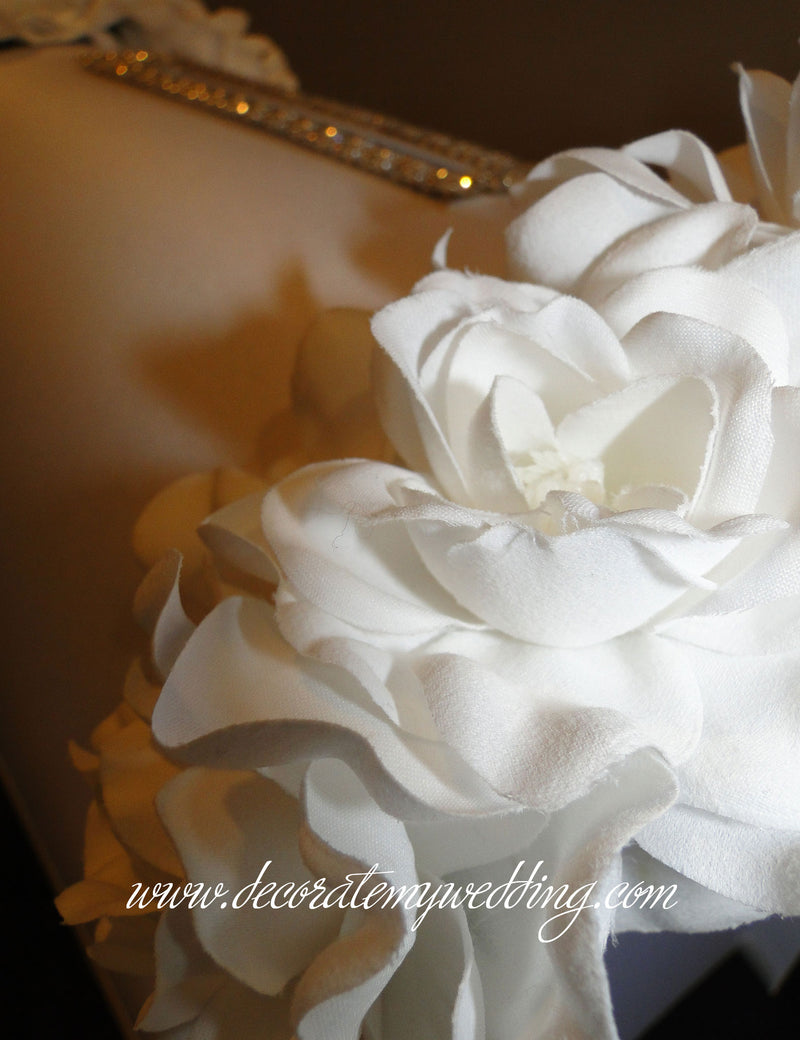 A close up view of the soft gardenia blooms.