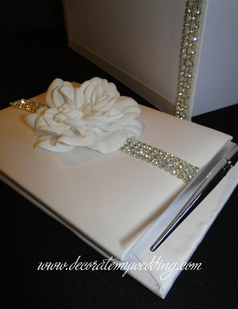 The matching guest book is also decorated with gardenia blooms.