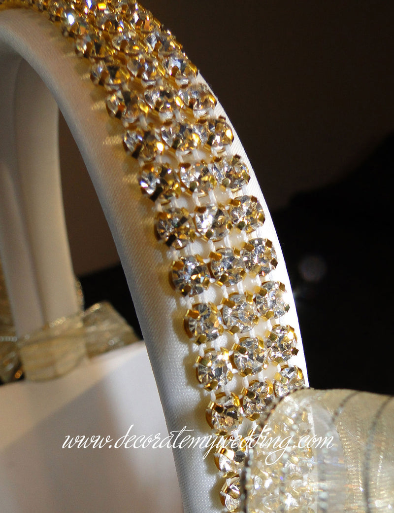 A close up look at gold rhinestone trim wrapping the basket handle.