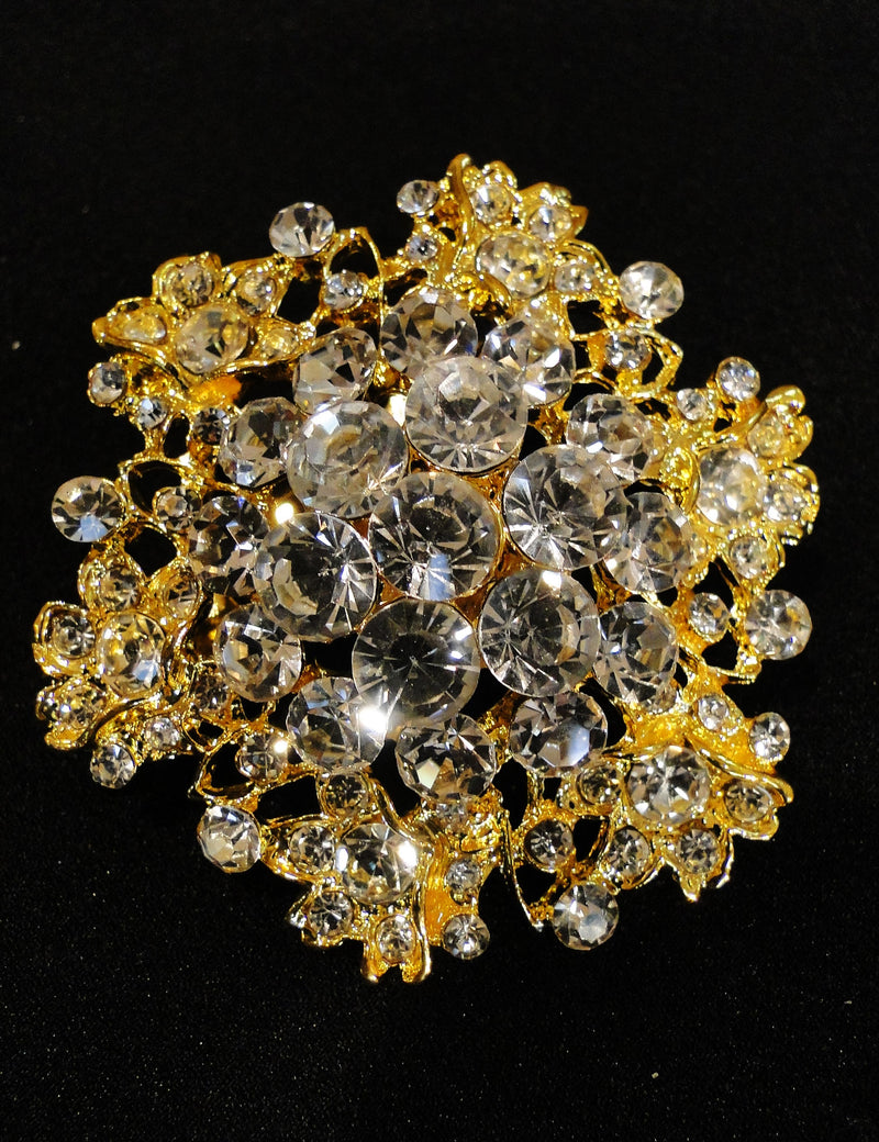 Gold rhinestone brooch is attached to the front of the basket.