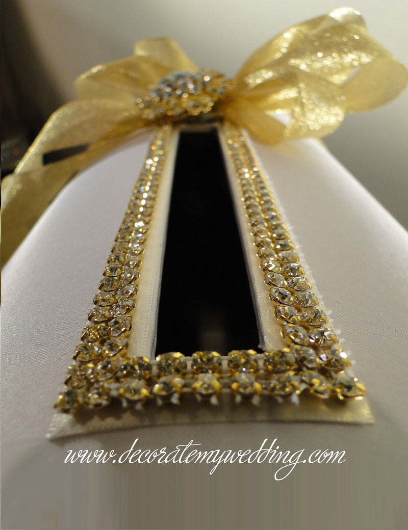 A close up look at gold rhinestone banding around the card box opening.