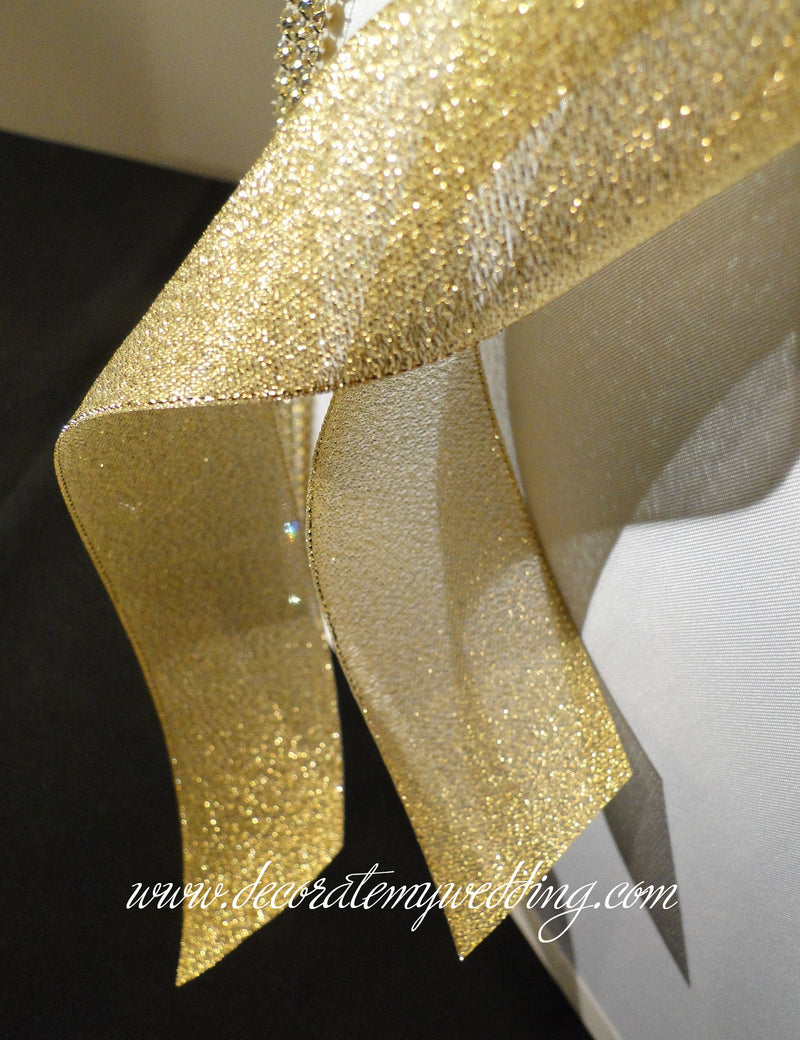 Close up look at the metallic gold ribbon used to trim the card box.