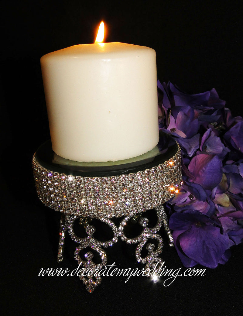 This handmade candle holder is completely covered with silver crystal rhinestones and holds a pillar size candle.
