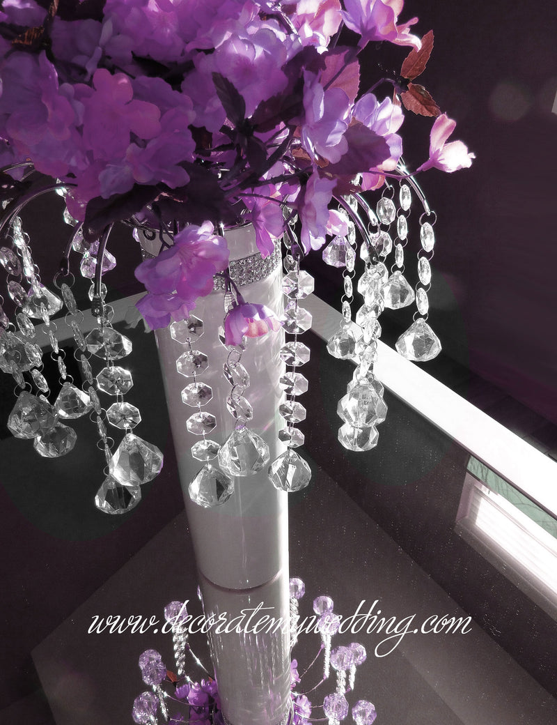 Everyone falls in love with this hanging bead decoration. The graceful arch extends over a bridal white vase with rhinestone banding.