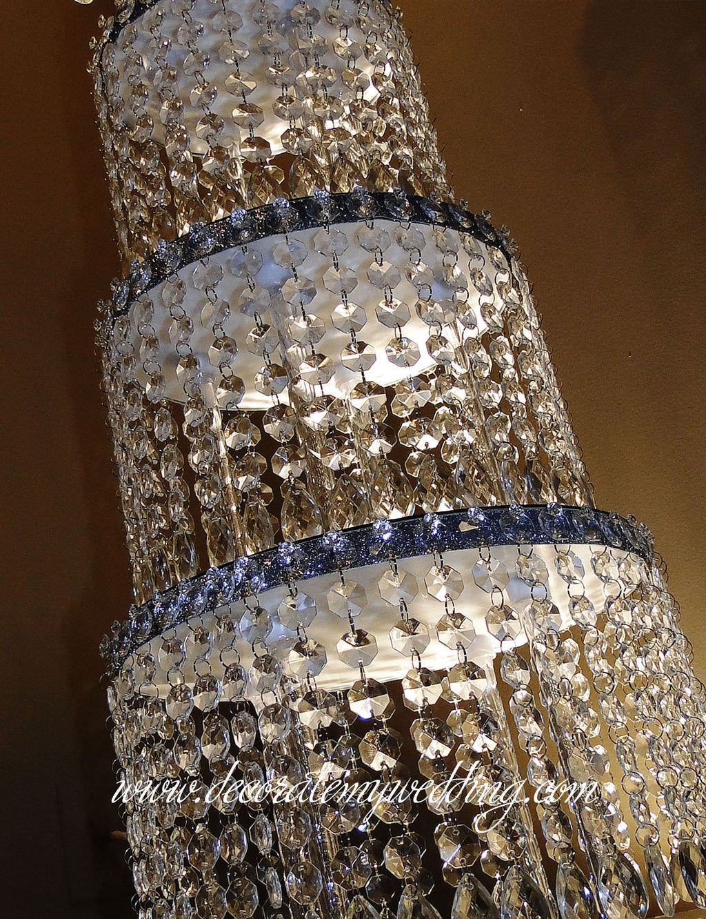 Stacked tiers of octagon bead strands create a large centerpiece that imitates an actual wedding cake.