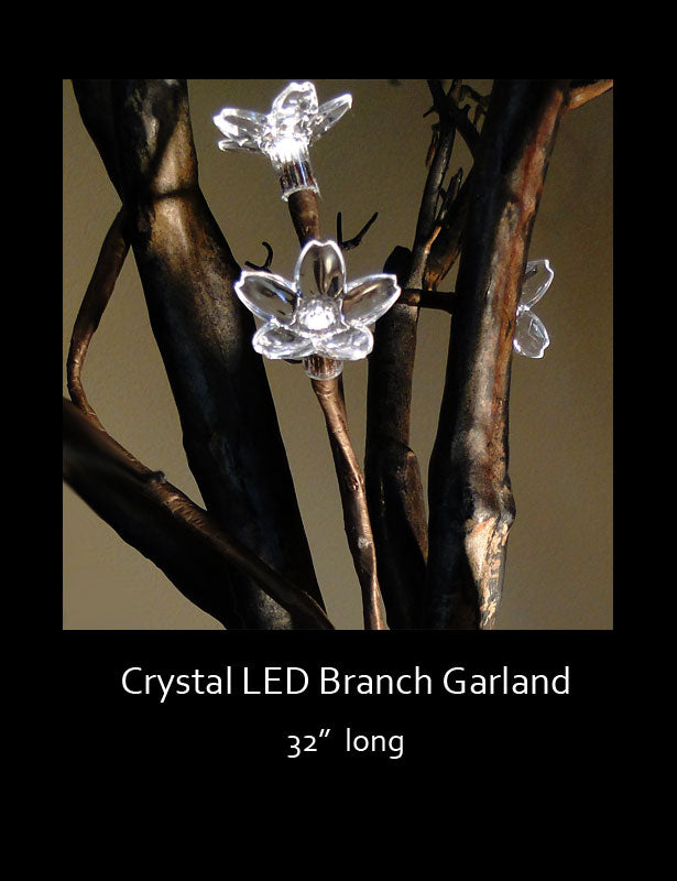 "The crystal LED lighted branch garland measures 32"" long and is powered by a battery pack."