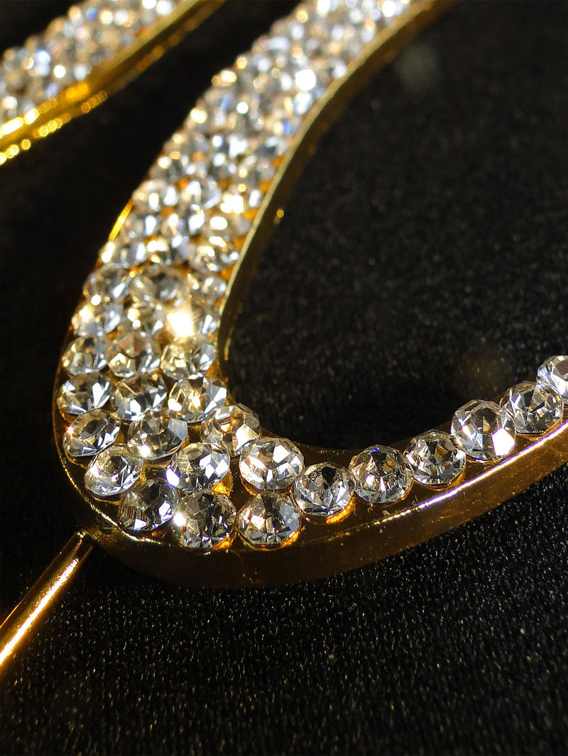 A close up look at the gold plated monogram with Swarovski rhinestones.