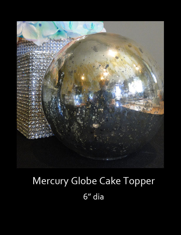 This mercury globe has a gorgeous reflective surface which will pick up the color of its surroundings.