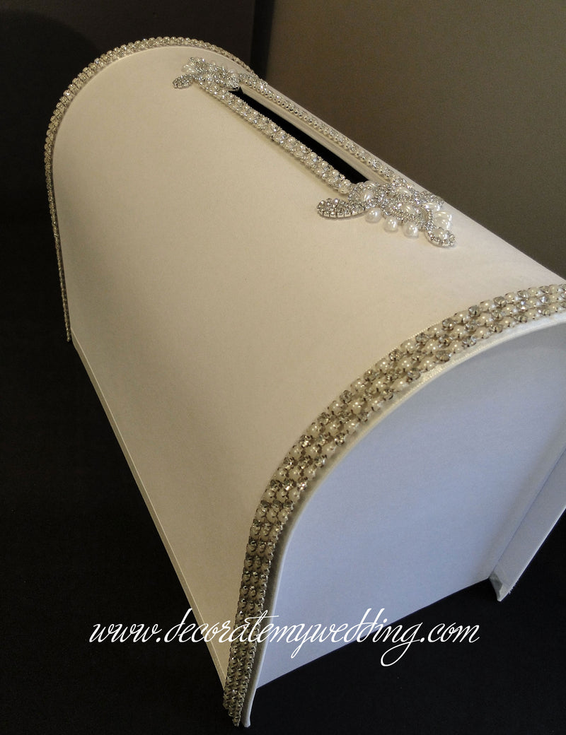 A top view of the card box with pearl-themed accents.